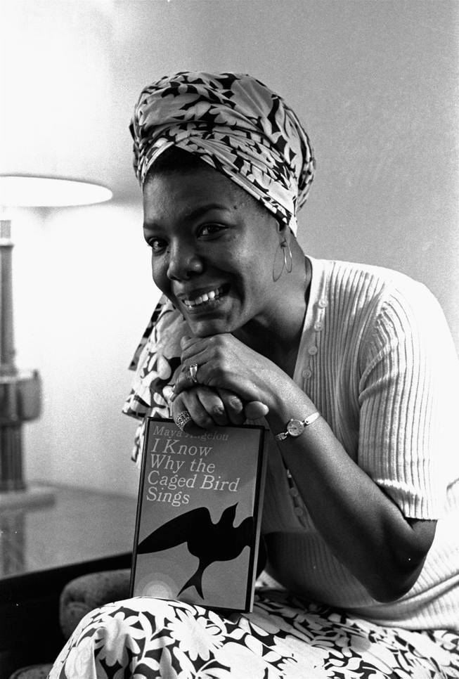 "In this Nov. 3, 1971 file photo, Maya Angelou poses with a copy of her book, ""I Know Why the Caged Bird Sings,"" in Los Angeles. Angelou, a Renaissance woman and cultural pioneer, has died, Wake Forest University said in a statement Wednesday, May 28, 2014. She was 86."