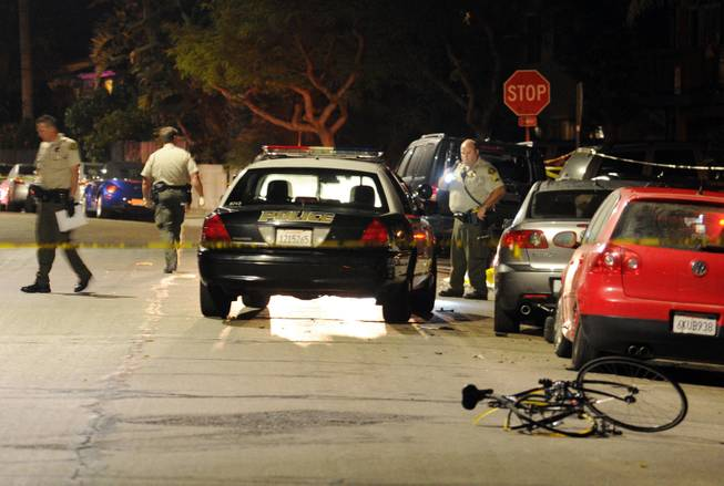 In this image provided by the Santa Barbara Independent, police investigate the scene after a mass shooting near the campus of the University of Santa Barbara in Isla Vista, Calif., Friday, May 23, 2014.