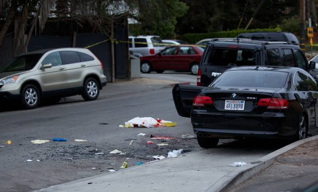 Police tape marks off the scene of a drive-by shooting that left seven people dead, including the attacker, and others wounded on Friday, May 23, 2014, in Isla Vista, Calif.