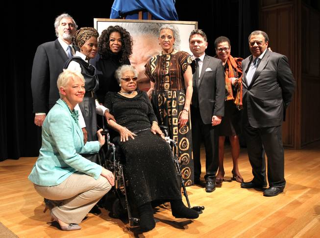 Left to right, Kim Sajet, Richard Kurin, Cicely Tyson, Oprah Winfrey, Maya Angelou, Johnnetta Cole, Ross Rossin, Eleanor Holmes Norton and Amb. Andrew Young pose for a photo at Maya Angelou's portrait unveiling at the Smithsonian's National Portrait Gallery on Saturday, April 5, 2014 in Washington, DC.