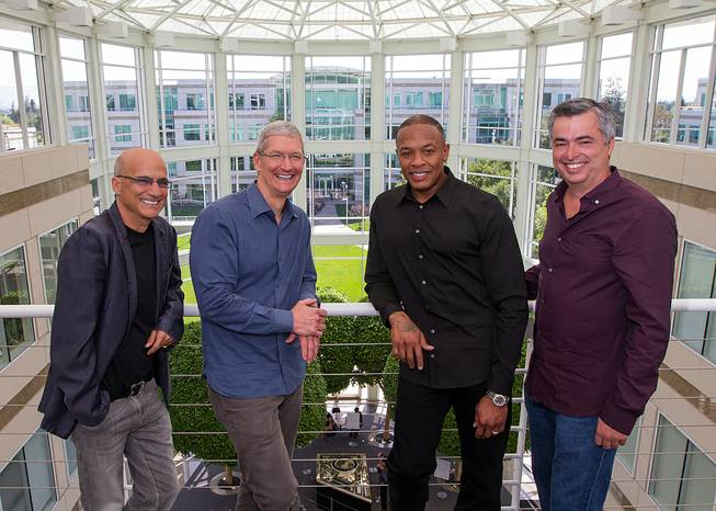 In this image provided by Apple, music entrepreneur and Beats co-founder Jimmy Iovine, Apple CEO Tim Cook, Beats co-founder Dr. Dre and Apple Senior Vice President Eddy Cue are at Apple headquarters in Cupertino, Calif., on Wednesday, May 28, 2014.
