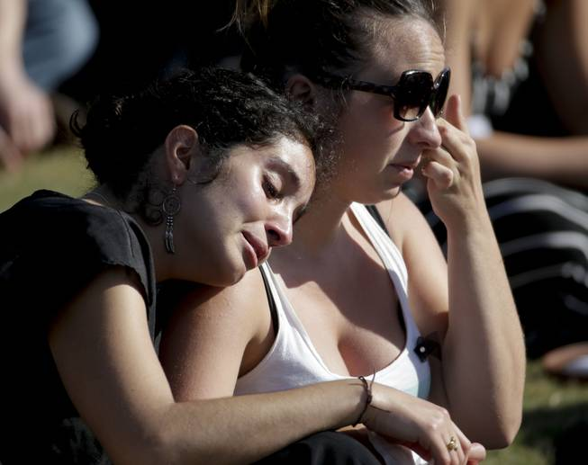 Students cry during a memorial service for the victims and families of Friday's rampage at Harder Stadium on the campus of University of California, Santa Barbara on Tuesday, May 27, 2014, in the Isla Vista area near Goleta, Calif.