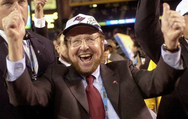 Tampa Bay Buccaneers owner Malcolm Glazer celebrates the Bucs' 48-21 victory over the Oakland Raiders in Super Bowl XXXVII on Jan. 26, 2003, in San Diego. Glazer, the self-made billionaire who owned the NFL's Tampa Bay Buccaneers and English soccer's Manchester United, has died. He was 85. The Bucs said Glazer died Wednesday, May 28, 2014.