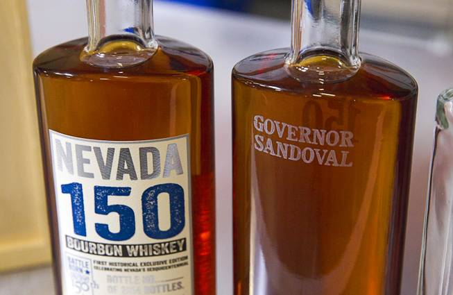 "Bottles of Nevada's first bourbon whiskey are shown at the Las Vegas Distillery in Henderson Thursday, May 29, 2014. Nevada Governor Brian Sandoval helped fill the first bottle of ""Nevada 150,"" a bourbon whiskey created for the Nevada sesquicentennial. The bourbon has a limited run of 2,000 bottles."