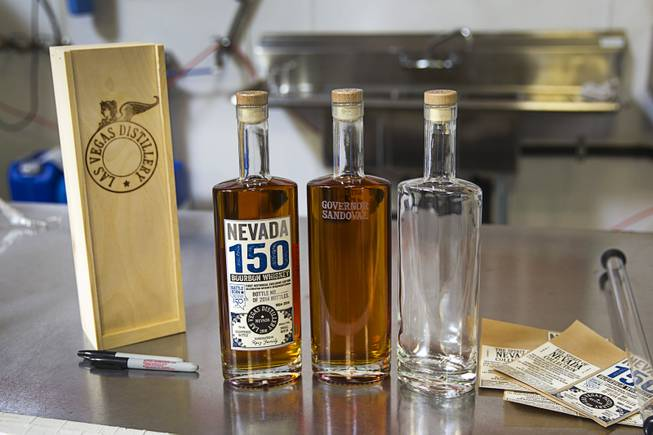 "Bottles of ""Nevada 150,"" a bourbon whiskey are shown at the Las Vegas Distillery in Henderson Thursday, May 29, 2014. Governor Sandoval helped fill the first bottle of ""Nevada 150,"" a bourbon whiskey created for the Nevada sesquicentennial."
