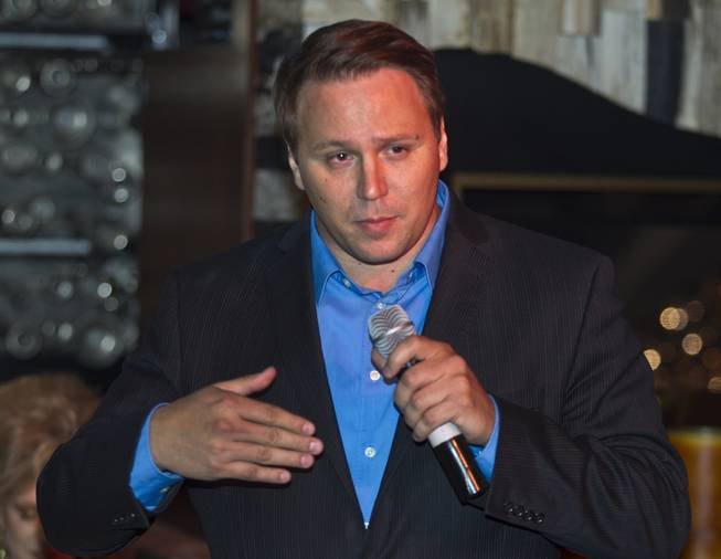 State Senate District 20 candidate Carl Bunce introduces his platform to Libertarian party members and guests during a meet and greet session at Hyde in the Bellagio on Thursday, May 29, 2014.