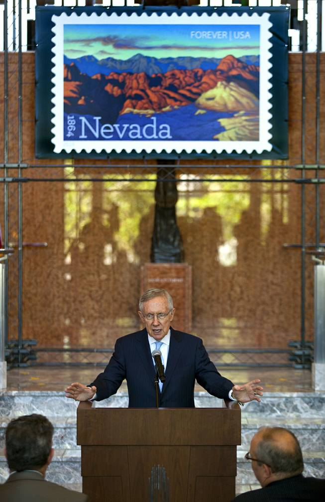 Senator and Majority Leader Harry Reid gives stamp dedication remarks during the unveiling ceremony of the Nevada Sesquicentennial commemorative stamp at the Smith Center on Thursday, May 29, 2014.