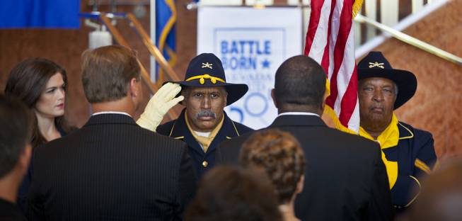 Buffalo Soldiers present the colors as the United States Postal Service and the Nevada Sesquicentennial Commission unveil the Nevada Sesquicentennial commemorative stamp at the Smith Center on Thursday, May 29, 2014.
