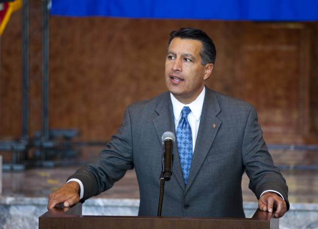 Governor Brian Sandoval shares his love of Nevada  during the unveiling ceremony of the Nevada Sesquicentennial commemorative stamp at the Smith Center on Thursday, May 29, 2014.