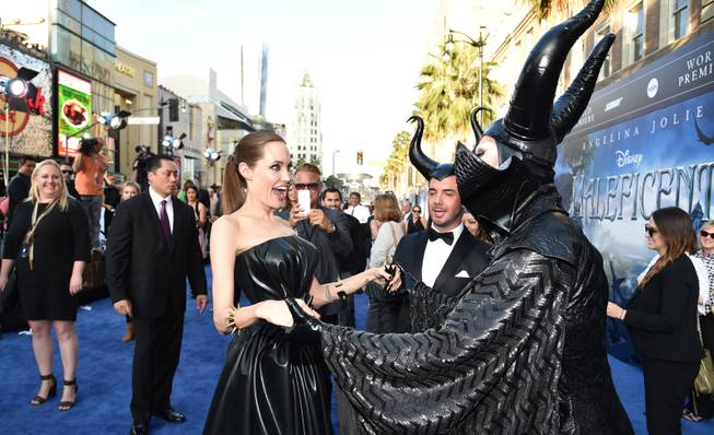"Angelina Jolie, right, arrives at the world premiere of ""Maleficent"" at the El Capitan Theatre on Wednesday, May 28, 2014, in Los Angeles."