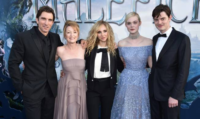 "Sharlto Copley, and from left, Lesley Manville, Juno Temple, Elle Fanning and Sam Riley arrive at the world premiere of ""Maleficent"" at the El Capitan Theatre on Wednesday, May 28, 2014, in Los Angeles."