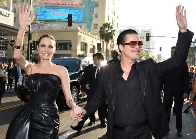 "Angelina Jolie, left, and Brad Pitt arrive at the world premiere of ""Maleficent"" at the El Capitan Theatre on Wednesday, May 28, 2014, in Los Angeles."