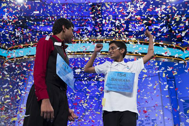 Ansun Sujoe, 13, of Fort Worth, Texas, left, and Sriram Hathwar, 14, of Painted Post, N.Y., celebrate after being named co-champions of the National Spelling Bee, on Thursday, May 29, 2014, in Oxon Hill, Md.
