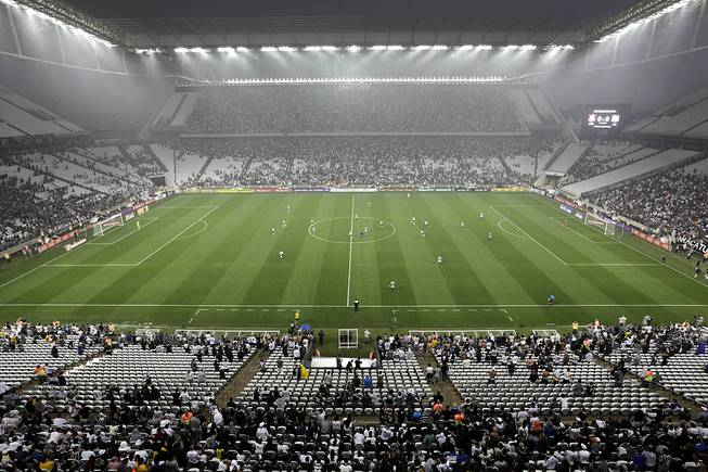 Corinthians's and Figueirense players battle it out during a Brazilian soccer league match at the Itaquerao, the still unfinished stadium that will host the World Cup opener match between Brazil and Croatia on June 12, in Sao Paulo, Brazil, Sunday, May 18, 2014. Only 40,000 tickets were put on sale for Corinthians' match against Figueirense because some of the 20,000 temporary seats needed for the World Cup opener are still being installed.