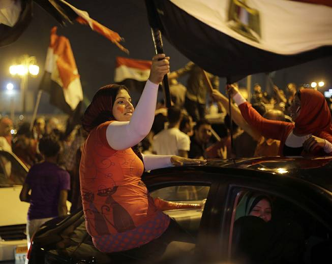 Supporters of presidential hopeful Abdel-Fattah el-Sissi, Egypt's former military chief, wave national flags during a celebration at Tahrir Square in Cairo, Egypt, Thursday, May 29, 2014. El-Sissi appeared well on his way to a landslide victory over his sole opponent, according to partial election results announced late Wednesday, after voting was extended for a third day in an attempt to prevent an embarrassment over low turnout.