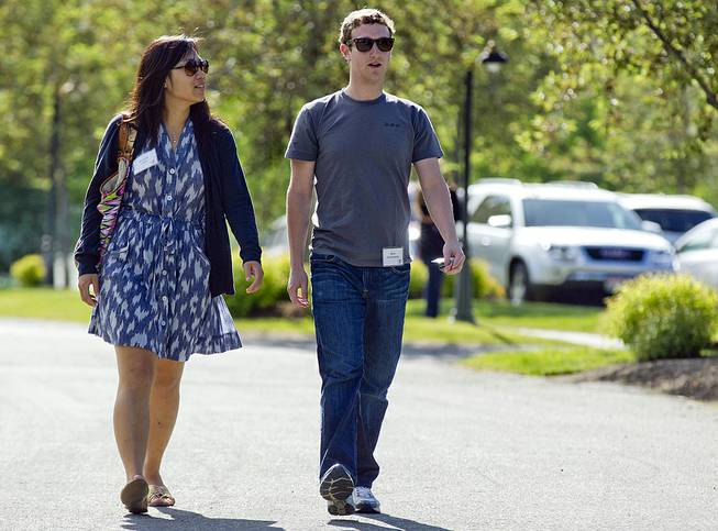 In this July 9, 2011, file photo, Mark Zuckerberg, president and CEO of Facebook, walks with Priscilla Chan during the 2011 Allen and Co. Sun Valley Conference in Sun Valley, Idaho.