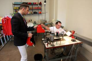 Guadalupe Calderon hands a sample to Derek Smoot at the Dapper Factory Friday, May 23, 2014.