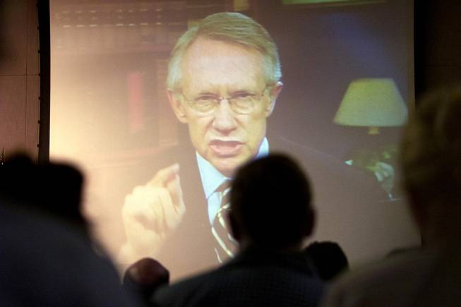 Via satellite from Washington D.C., Sen. Harry Reid addresses representatives from the Department of Energy during the DoE's public hearing on the proposed Yucca Mountain Repository Sept. 5, 2001.