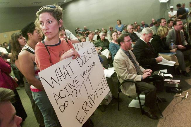 A protestor holds a sign during the Department of Energy's public hearing on the proposed Yucca Mountain Repository Sept. 5, 2001.
