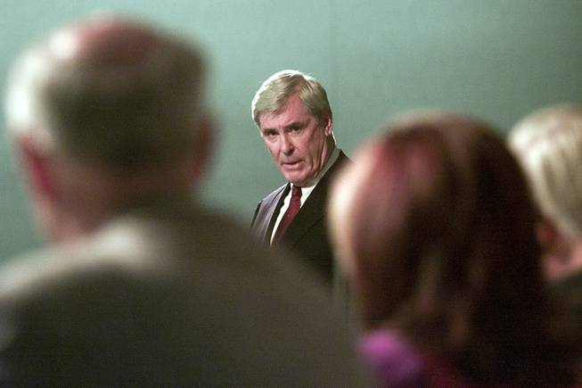 Governor Kenny Guinn addresses representatives from the Department of Energy during the DoE's public hearing on the proposed Yucca Mountain Repository Sept. 5, 2001.