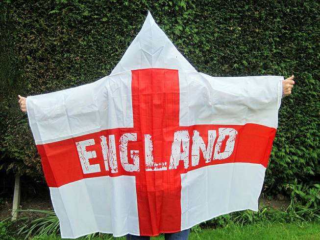 A man models a wearable England flag, made by Asda, in London, Friday, May 30, 2014. British supermarket chain Asda has been criticized for launching a wearable England flag ahead of the World Cup that some customers say resembles an outfit worn by U.S. far-right organization the Ku Klux Klan.