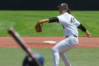 UNLV's John Richy delivers a pitch in the first inning against UC Irine at the NCAA college baseball tournament regional in Corvallis, Ore., Friday, May 30, 2014. (AP Photo/Mark Ylen)