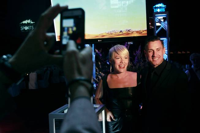 Carey Hart and his wife Alecia Beth Moore Hart, better known as the pop singer Pink, pose for photos during the induction for the Southern Nevada Sports Hall of Fame Friday, May 30, 2014.