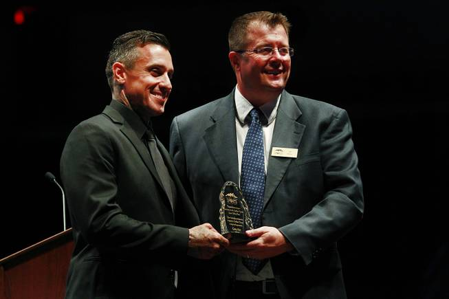 Carey Hart and Southern Nevada Sports Hall of Fame chairman Jeff Motley pose for photos after Hart's induction into the Southern Nevada Sports Hall of Fame Friday, May 30, 2014.