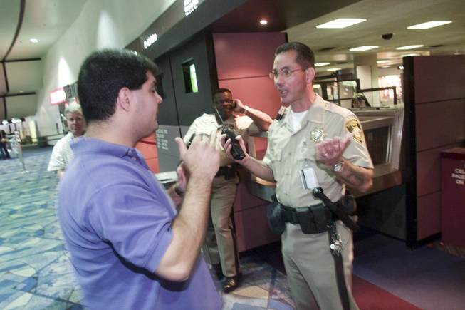A man is denied passage to the gate area by Metro Police officer Frank Mandracchio at McCarran International Airport Tuesday, Sept. 11, 2001.