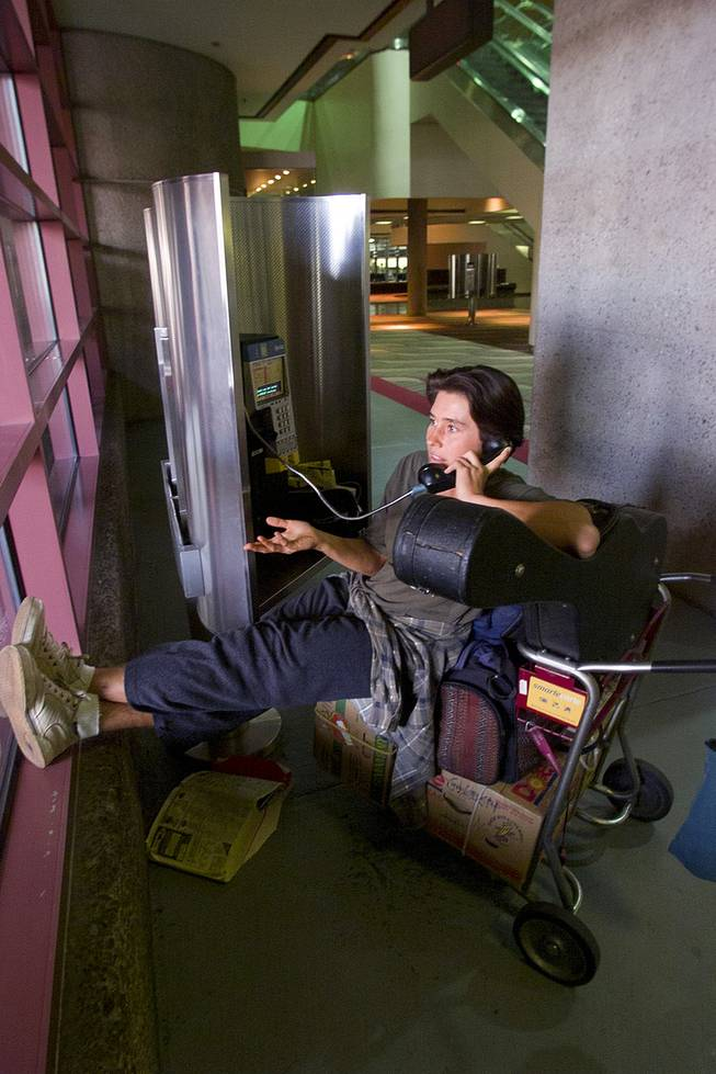A woman stranded at McCarran International Airport makes a phone call to relatives Tuesday, Sept. 11, 2001.