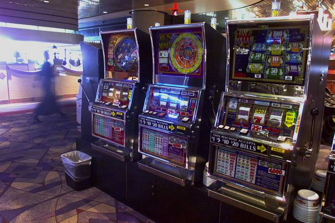 Slot machines are shown turned off at McCarran International Airport Tuesday, Sept. 11, 2001.