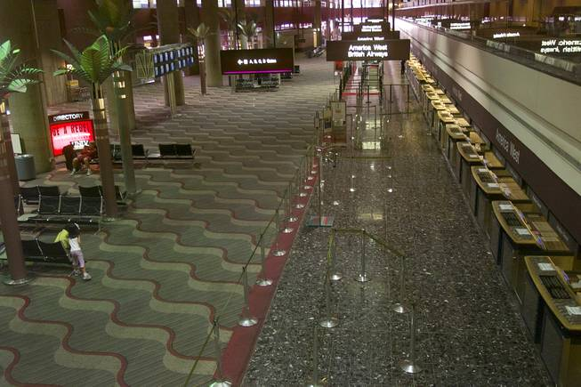 Ticketing counters are seen empty at McCarran International Airport Tuesday, Sept. 11, 2001.