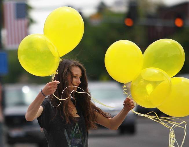 Rachel Malone, 17, ties balloons along Main Street in Hailey, Idaho on Saturday, May 31, 2014 after the announcement that U.S. Army Sgt. Bowe Bergdahl has been released from captivity. Bergdahl, 28, had been held prisoner by the Taliban since June 30, 2009. He was handed over to U.S. special forces by the Taliban in exchange for the release of five Afghan detainees held by the United States. (AP Photo/The Times-News, Drew Nash)