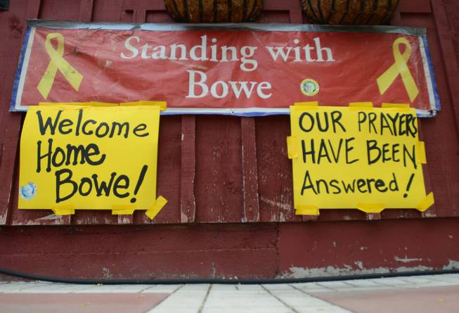 New signs hang at Zaney's coffee house in Hailey, Idaho on Saturday, May 31, 2014 after the announcement that U.S. Army Sgt. Bowe Bergdahl has been released from captivity. Bergdahl, 28, had been held prisoner by the Taliban since June 30, 2009. He was handed over to U.S. special forces by the Taliban in exchange for the release of five Afghan detainees held by the United States. (AP Photo/The Times-News, Drew Nash)