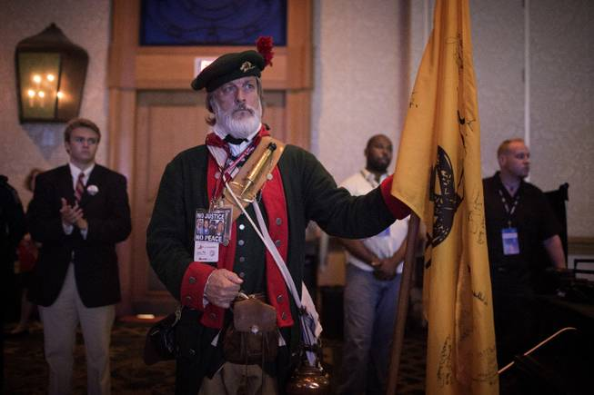 William Temple, a Tea Party activist, listens to Louisiana governor Bobby Jindal speak at the Republican Leadership Conference in New Orleans, May 29, 2014. After establishment candidates won a series of primaries this year, Republican leaders are considering tough tactics to head off further attacks from the Tea Party.(Edmund D. Fountain/The New York Times)