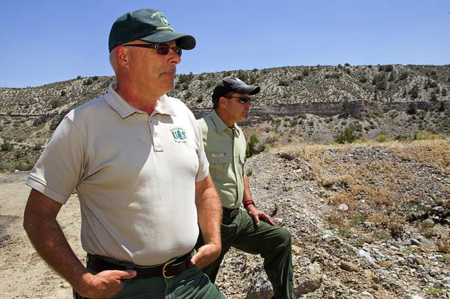 Randy Swick, left, Spring Mountains National Recreation Area manager, and Ron Bollier, a U.S. Forest Service fire management officer, look over an area near Harris Springs Road and Kyle Canyon Road on Mt. Charleston Tuesday, May 27, 2014. The mountain is showing signs of recovery, about one year after the Carpenter 1 Fire that scorched almost 28,000 acres in 2013.