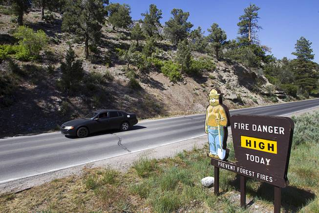 A signs lists the fire danger level on Mt. Charleston Tuesday, May 27, 2014. The mountain is showing signs of recovery, about one year after the Carpenter 1 Fire that scorched almost 28,000 acres in 2013.