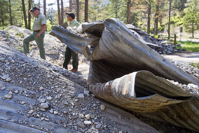James Hurja, left, a USFS soil scientist and burn response coordinator for Mt. Charleston, and Ron Bollier, a USFS fire management officer, stand by a washed-out bridge near Forest Service administrative offices is shown on Mt. Charleston Tuesday, May 27, 2014. The bridge was destroyed by run-off after the Carpenter 1 Fire in 2013.