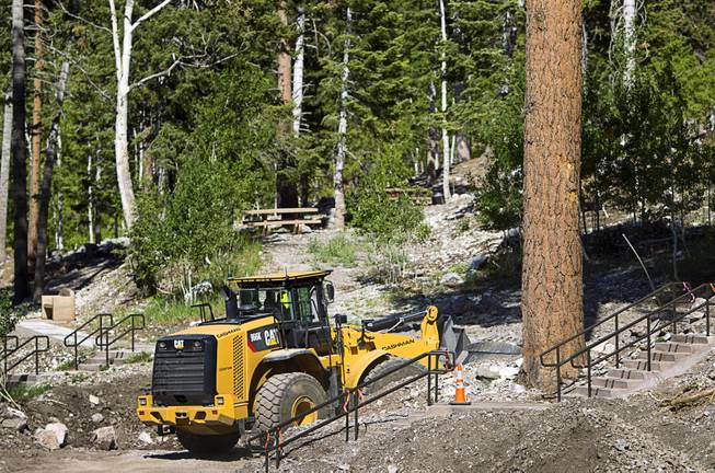 A worker makes improvements to a drainage area at the Cathedral Rock Picnic Area on Mt. Charleston Tuesday, May 27, 2014. The area was damaged by flood run-off and debris following the Carpenter 1 Fire that scorched almost 28,000 acres in 2013.