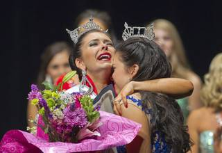 Ellie Smith and Amy Smith embrace after the sisters won the 2014 Miss Nevada and Miss Nevada's Outstanding Teen Pageants, respectively, at the Las Vegas Academy of the Arts Theater on Sunday, June 1, 2014.
