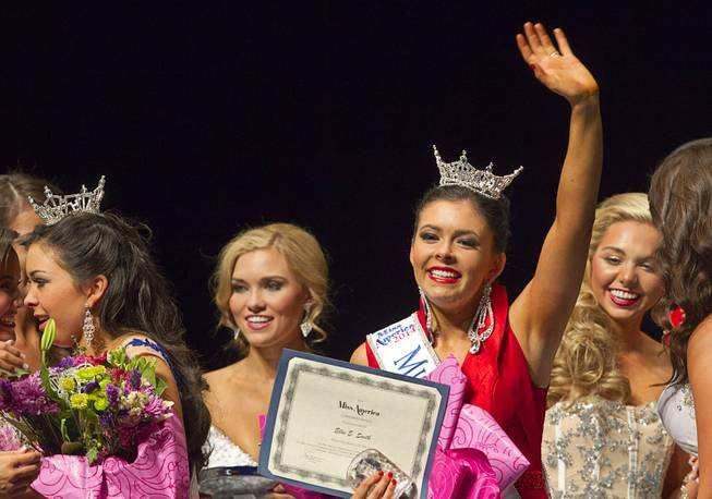 Ellie Smith, right, of Henderson waves after being crowned 2014 Miss Nevada at the Miss Nevada and Miss Nevada Outstanding Teen Pageant at the Las Vegas Academy Theater Sunday, June 1, 2014. Her sister Amy Smith, left, was crowned 2014 Miss Nevada Outstanding Teen.