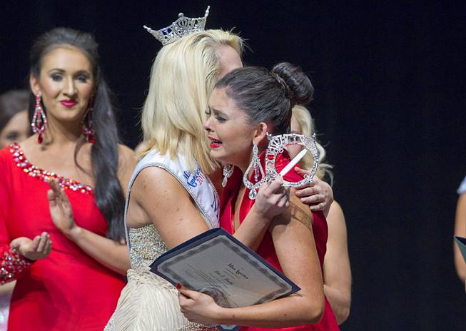 Ellie Smith, right, of Henderson gets a hug by 2013 Miss Nevada Diana Sweeney after being named 2014 Miss Nevada at the Miss Nevada and Miss Nevada Outstanding Teen Pageant at the Las Vegas Academy Theater Sunday, June 1, 2014. Her sister Amy Smith was crowned 2014 Miss Nevada Outstanding Teen.