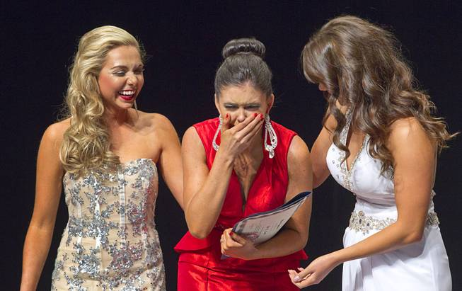 Ellie Smith, center, of Henderson reacts as she is named 2014 Miss Nevada at the Miss Nevada and Miss Nevada Outstanding Teen Pageant at the Las Vegas Academy Theater Sunday, June 1, 2014. Her sister Amy Smith was crowned 2014 Miss Nevada Outstanding Teen.