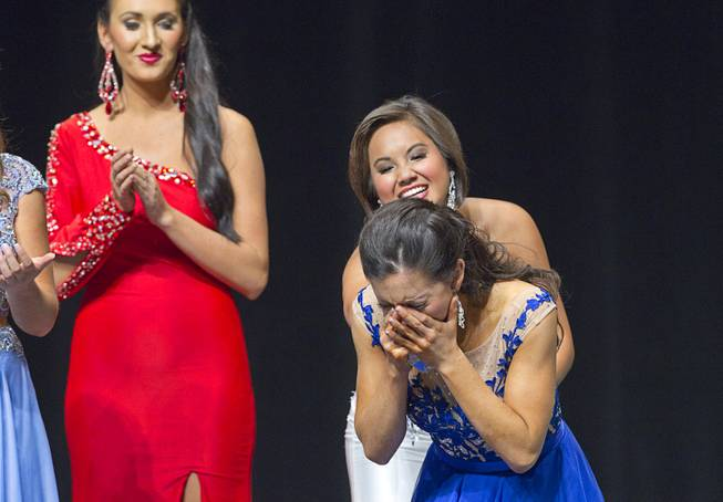 Amy Smith of Henderson reacts as she is named 2014 Nevada Outstanding Teen at the Miss Nevada and Miss Nevada Outstanding Teen Pageant at the Las Vegas Academy Theater Sunday, June 1, 2014. Amy's sister Ellie Smith later was crowned 2014 Miss Nevada.