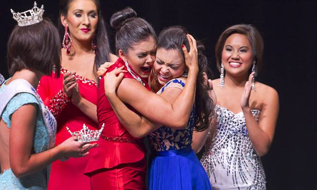 Ellie Smith, left, gives a hug to her sister Amy Smith after Amy was named Miss Nevada's Outstanding Teen at the Las Vegas Academy of the Arts Theater on Sunday, June 1, 2014. Ellie Smith was later crowned 2014 Miss Nevada.
