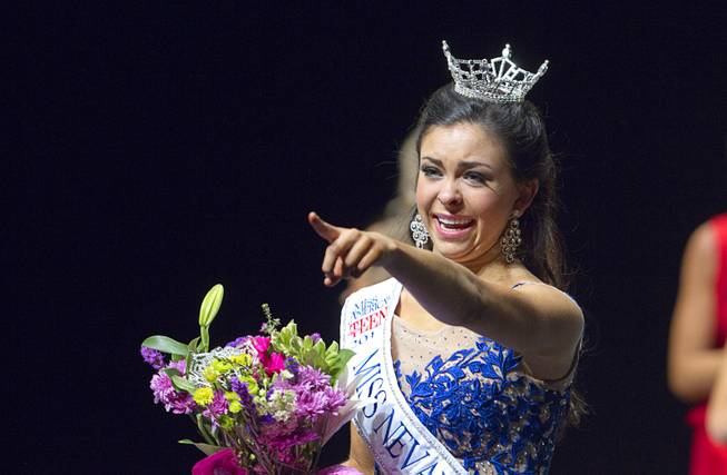 Amy Smith points to someone in the audience after being crowned Miss Nevada Outstanding Teen at the Miss Nevada and Miss Nevada Outstanding Teen Pageant at the Las Vegas Academy Theater Sunday, June 1, 2014. Her sister Ellie Smith later won 2014 Miss Nevada.