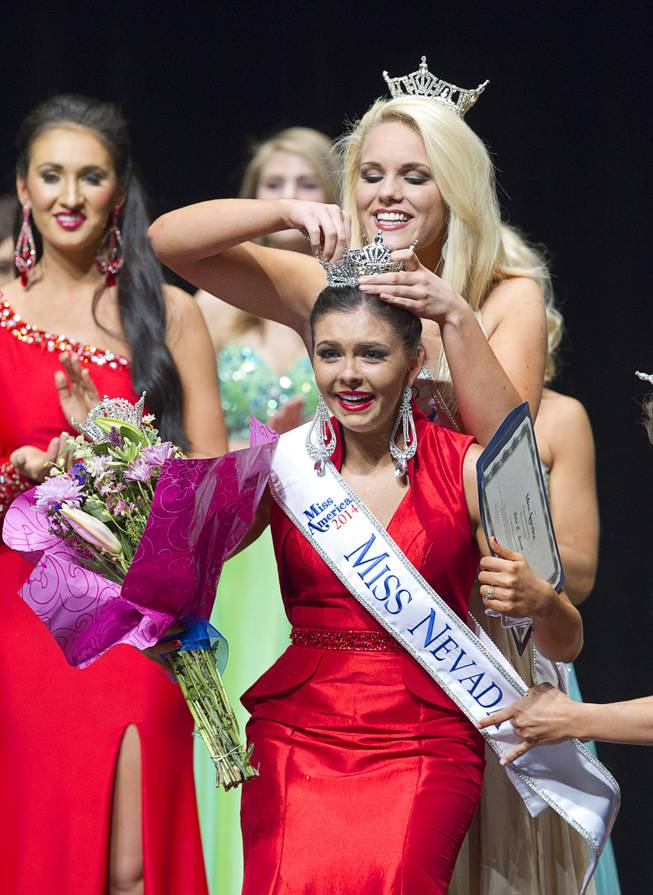 Ellie Smith of Henderson reacts as she is crowned 2014 Miss Nevada by 2013 Miss Nevada Diana Sweeney at the Miss Nevada and Miss Nevada Outstanding Teen Pageant at the Las Vegas Academy Theater Sunday, June 1, 2014. Her sister Amy Smith was crowned 2014 Miss Nevada Outstanding Teen.