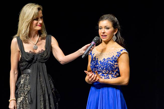 Dana Rogers-Martin, left, 1983 Miss Texas, holds the microphone for Amy Smith during the Miss Nevada and Miss Nevada Outstanding Teen Pageant at the Las Vegas Academy Theater Sunday, June 1, 2014. Smith was later crowned 2014 Miss Nevada Outstanding Teen.