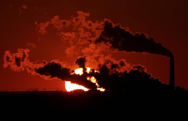 In this March 8, 2014, file photo steam from the Jeffrey Energy Center coal-fired power plant is silhouetted against the setting sun near St. Marys, Kan. As President Barack Obama prepares to announce tougher new air quality standards affecting coal-fired power plants, lawmakers in about a half-dozen state already have acted pre-emptively. Not to toughen their own standards, but to make it tougher to enforce the new federal ones.