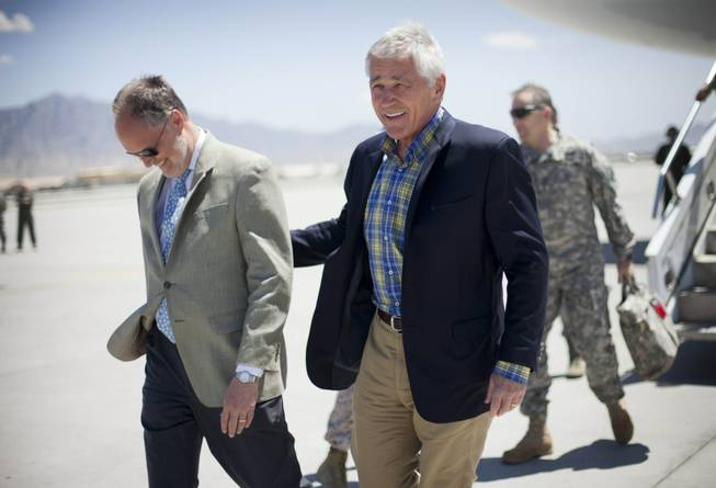 U.S. Defense Secretary Chuck Hagel, right, walks on the tarmac with U.S. Ambassador to Afghanistan James Cunningham, left, during his arrival to Bagram Airfield in Afghanistan, Sunday, June 1, 2014.
